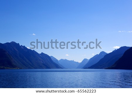 Image of sea and mountains landscape with blue gradient color. - stock photo