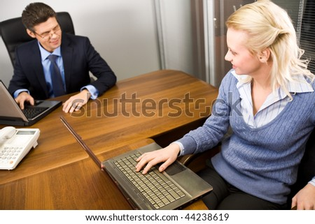 Image of secretary and boss communicating in the office at work - stock photo