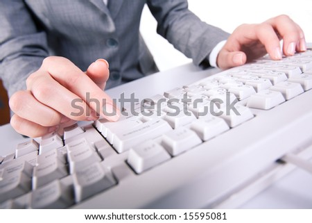 Image of secretaryâ??s hands while pressing enter button during computer work - stock photo