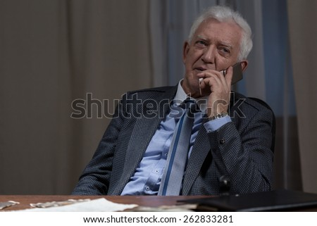 Image of senior businessman being on the phone - stock photo