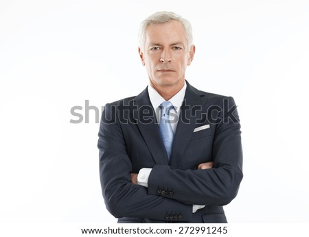 Image of senior lawyer wearing suit while standing against white background. Waist up portrait. Isolated on white background. - stock photo