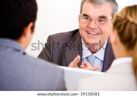 Image of senior leader communicating with his workers - stock photo