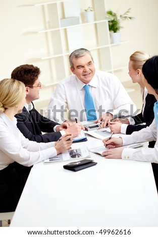 Image of senior leader making speech at meeting - stock photo