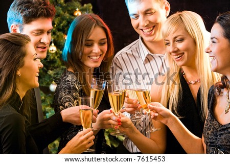Image of several attractive friends making a clink of champagne bocals