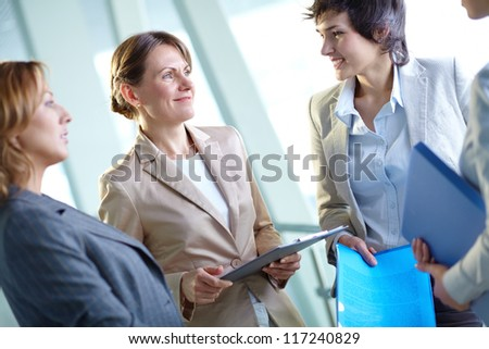 Image of several businesswomen interacting at meeting - stock photo