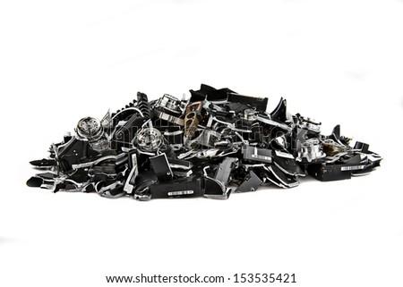 Image of several demolished hard drives on white - stock photo