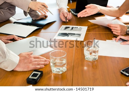 Image of several human hands during business seminar - stock photo