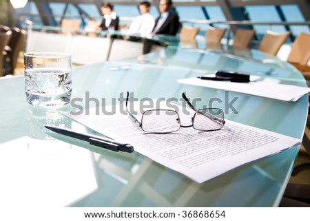 Image of several objects lying on the table in the conference room - stock photo