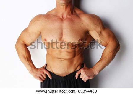 Image of sexy body builders body, isolated on white - stock photo