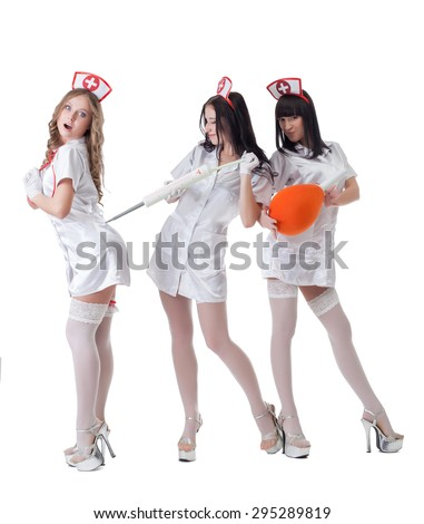 Image of sexy nurses fooling around at camera - stock photo