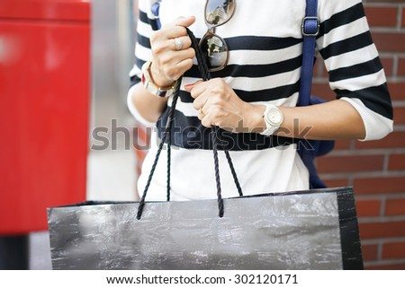 Image of shopaholic arm with  shopping bags - stock photo