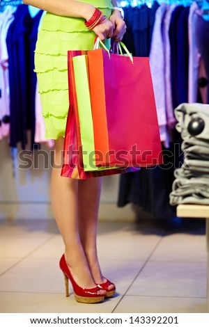 Image of shopaholic with shopping bags in clothing department - stock photo