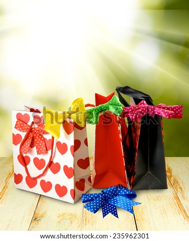 image of shopping bags against the sun - stock photo