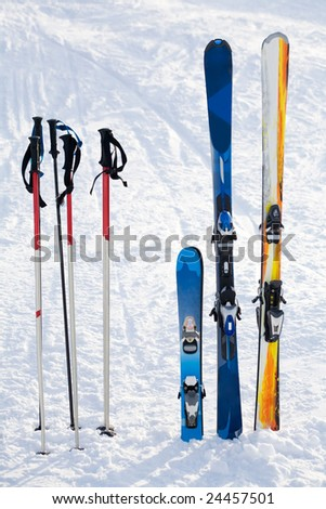 Image of skis and sticks in snowdrift on winter resort