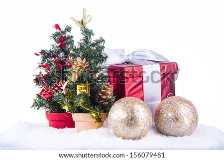 image of small chrystmas trees, present box with selective focus