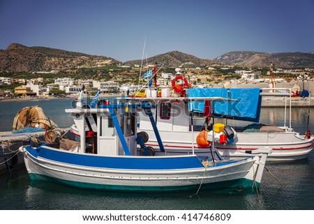 Image of small fishing boats in the village port. Makrigialos, Crete.  - stock photo