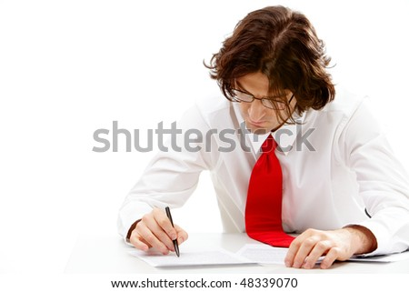 Image of smart business man writing something on document