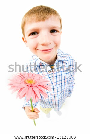 Image of smiling boy giving the pink flower