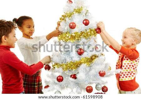 Image of smiling children decorating Christmas tree - stock photo