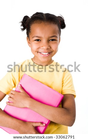 Image of smiling girl holding book on a white background - stock photo