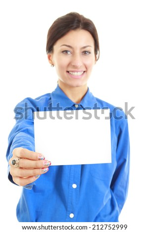 Image of smiling  pretty casual woman holding her large blank visiting card with one hand, copy space advertising