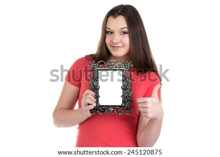 Image of smiling teenage girl with photo frame on white background - stock photo