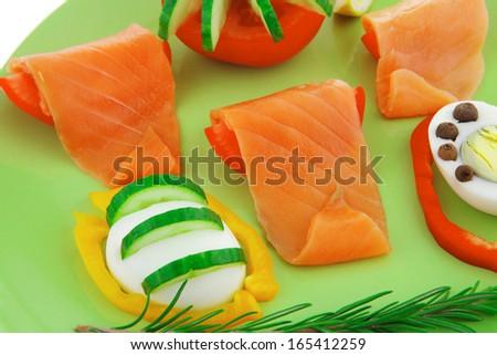 image of smoked salmon slices on green - stock photo