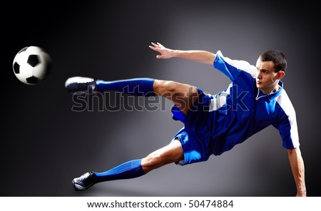 Image of soccer player doing flying kick with ball - stock photo