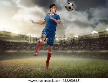 Image of soccer player header on the stadium - stock photo