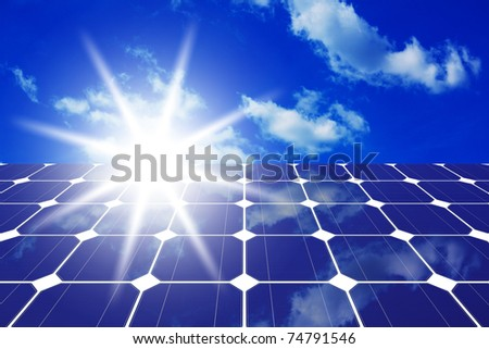 Image of solar panels - clean energy source on the background of sky and bright sun - stock photo