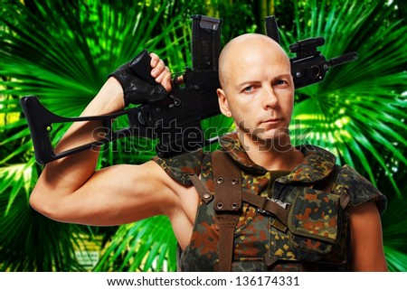 image of soldier with rifle in jungles - stock photo
