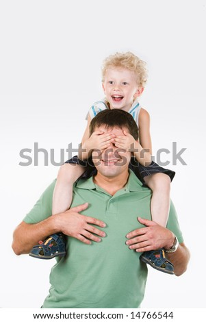 Image of son putting his palms on father's face - stock photo