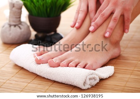 Image of SPA pedicure on bamboo surface - stock photo