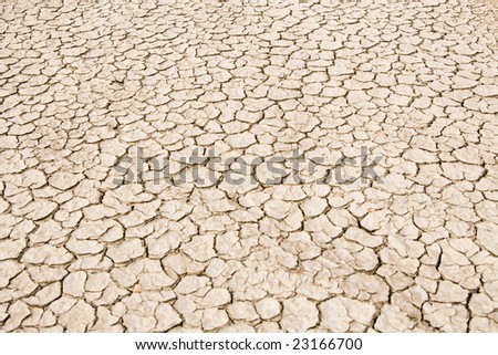 Image of splitting ground of desert with many cracks - stock photo