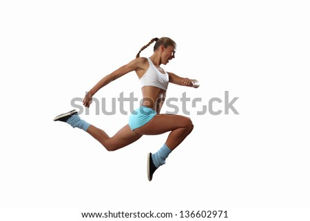Image of sport girl in jump against white background