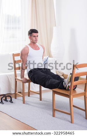 Image of sportsman doing workout at home