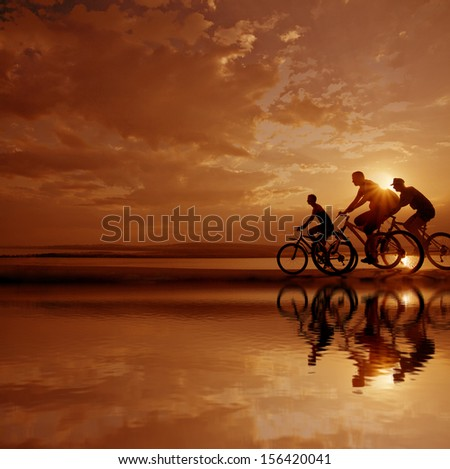 Image of sporty company friends on bicycles outdoors against sunset. Silhouette A lot phases of motion of a single cyclist along the shoreline coast Space for inscription