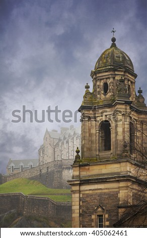 Image of St Johns church with Edinburgh castle in the background. Edinburgh, Scotland.  - stock photo