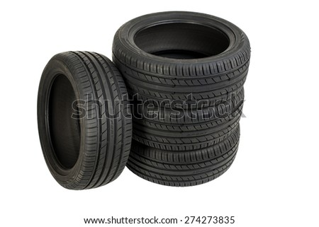 Image of Stack of four wheel new black tyres isolated on white - stock photo