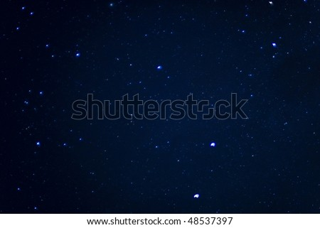 Image of stars in the sky at night .