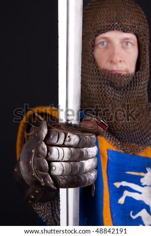 Image of steel sword in hands - stock photo