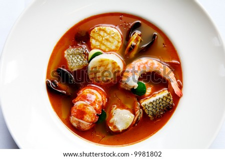 Image of stew consisting of lobster, shellfish, and other seafood - stock photo