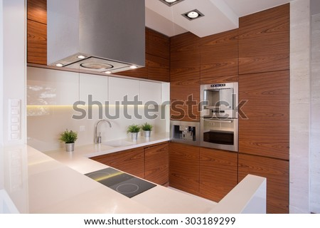 Image of stylish kitchen with ceramic decorative tiles