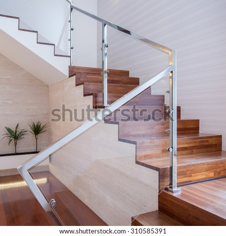 Image of stylish staircase in bright house interior - stock photo
