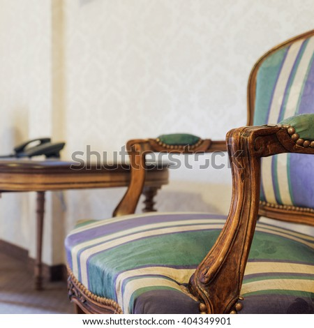 Image of stylish wooden colonial small table and armchairs