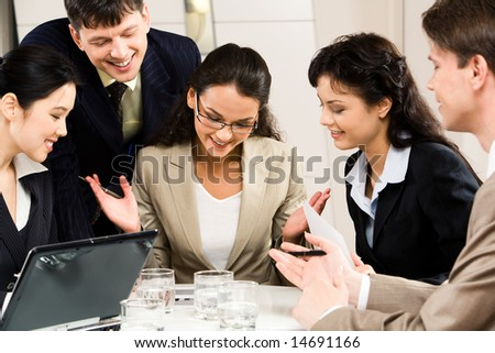 Image of successful businesswoman with four colleagues looking at plan near by - stock photo