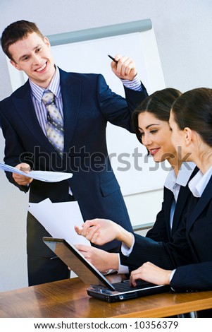 Image of successful man giving a report at business briefing - stock photo