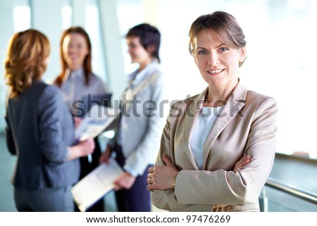 Image of successful middle aged businesswoman looking at camera - stock photo