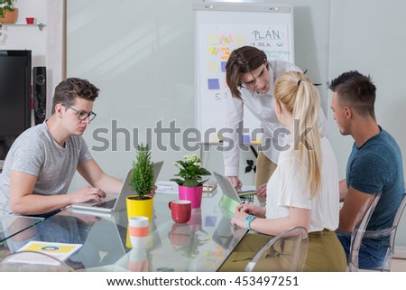 Image of successful middle aged businesswoman looking at camera during the meeting with clients - stock photo