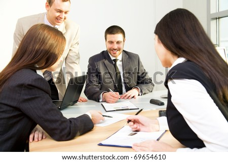 Image of successful partners discussing business plan at meeting - stock photo